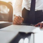 Close up business man signing contract making a deal, classic business; Shutterstock ID 334043420; PO: Order #4; Job: Corporate Communications; Client: Leasing Solutions